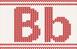 Red knitted Letter b on beige Background