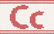 Red knitted Letter c on beige Background