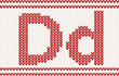 Red knitted Letter d on beige Background