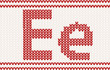 Red knitted Letter e on beige Background