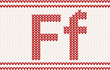 Red knitted Letter f on beige Background