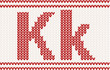 Red knitted Letter k on beige Background