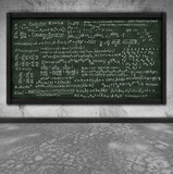 maths formula on chalkboard in classroom