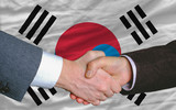 businessmen handshake after good deal in front of south korea fl