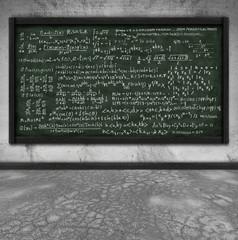 maths formula on chalkboard in classroom