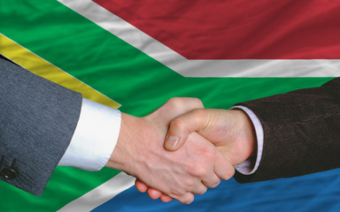 businessmen handshake after good deal in front of south africa f