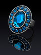Silver ring with blue stones (glass) with reflection.