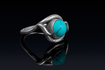 Silver ring with stone turkiz with reflection.