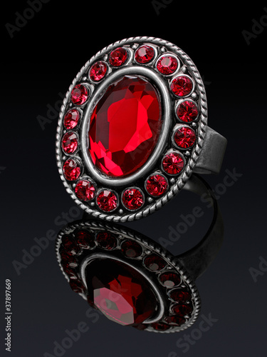 Silver ring with red stones ruby with reflection.