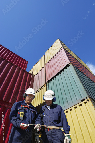 port workers and cargo containers
