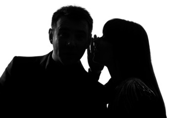 one couple man and woman whispering at ear
