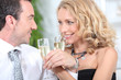 Closeup of couple drinking champagne