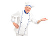 Portrait of smiling chef gesturing welcome