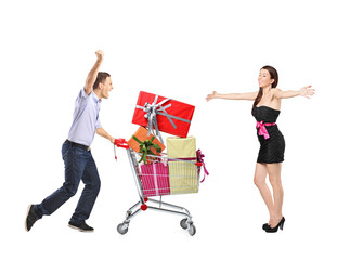 Surprised woman and a male pushing a shopping cart