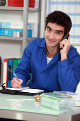 Worker with a phone and diary