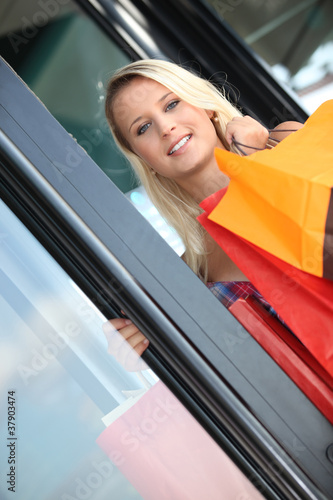 Woman leaving a store with shopping bags