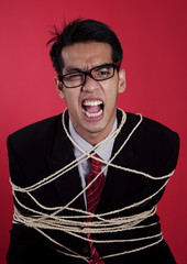 Mad businessman tied up