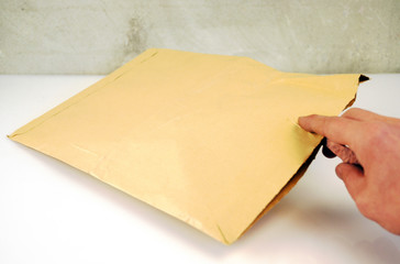 Brown Paper Letter with Hand