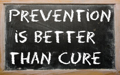 "Proverb ""Prevention is better than cure"" written on a blackboard"