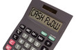 """Old calculator on white background showing text """"cash flow"""" in p"""