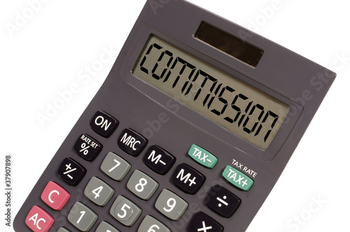 "Old calculator on white background showing text ""commision"" in p"