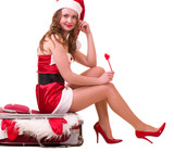woman in Santa Claus clothes dreaming about vacation