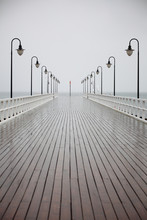 old pier in rain on Baltic sea Orlowo Gdynia Poland