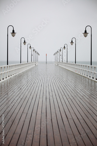 old pier in rain on Baltic sea Orlowo Gdynia Poland - 37909830