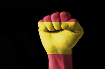 Fist painted in colors of spain flag