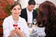 women drinking wine in a restaurant