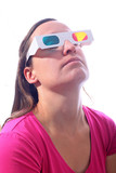 Young woman looking up  in 3d glasses