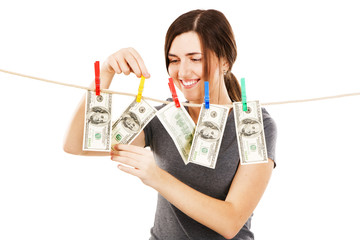 Young beautiful woman taking a dollar bill from the rope