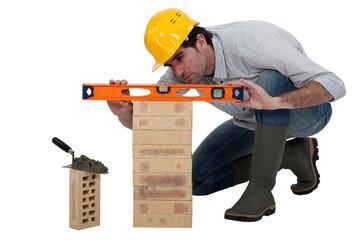 Tradesman using a spirit level