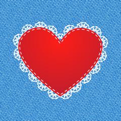 Red silk heart on denim background