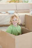 Boy hiding in cardboard box