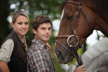 two young people and a horse