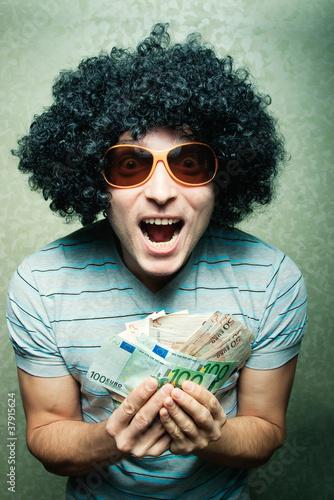 guy in afro curly wig with eyeglasses with lots of money