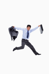 Cheerful businessman jumping while holding his jacket and a brie