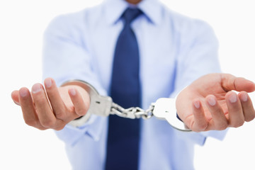 Close up of a professional's hands with handcuffs