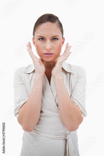 Portrait of a businesswoman with her hands around her face