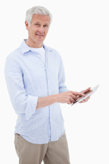 Portrait of a smiling mature man using a tablet computer