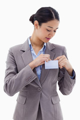 Portrait of a businesswoman clipping her badge