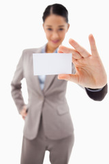 Portrait of a cute businesswoman showing a blank business card