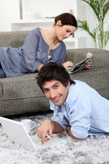 Couple relaxing at home on a Sunday