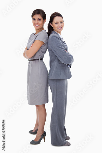 Businesswomen standing back on back
