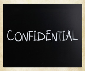 "The word ""Confidential"" handwritten with white chalk on a blackb"