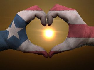 Heart and love gesture by hands colored in puertorico flag durin