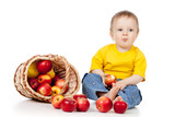 child eating red apples with basket
