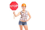 A construction worker holding a traffic sign stop