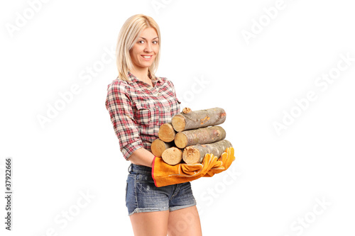 A young craftswoman holding fire wood